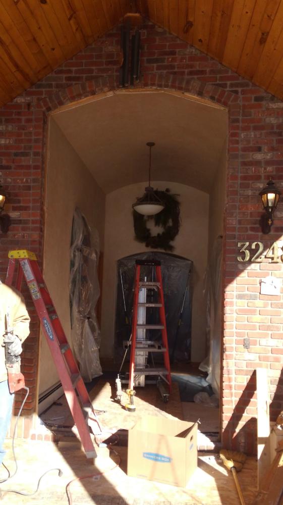 Copper clad entry door transom installation